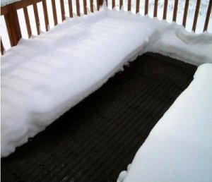 Heating mat on wheelchair ramp landing